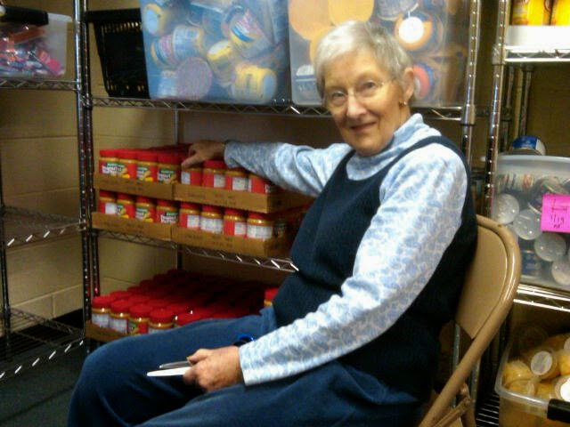 A volunteer helped get 1000 items sorted and shelved to fill bags this week.